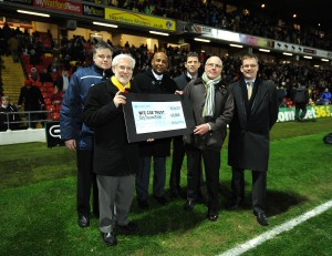 WST Chair Graham Sterry (2nd from r) and Treasurer Steve Temple (r) present the cheque to the Community Sports and Education Trust